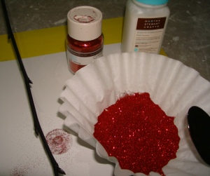 Gather glitter supplies.  I keep my glitter in a coffee filter so I can scoop it w a spoon & let the excess fall in the filter.  Or use a bog ol piece of paper for larger areas you plan to glitter.